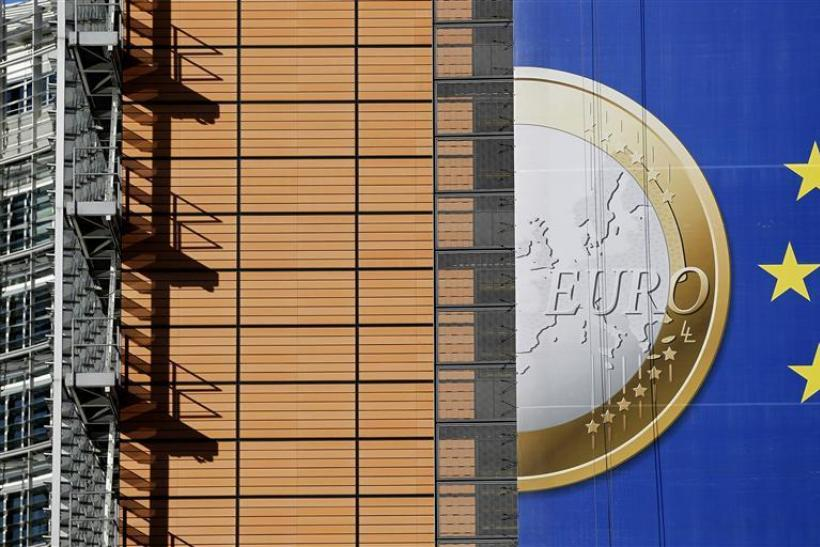 A banner showing a Euro coin ahead of a European Union heads of state summit in Brussels