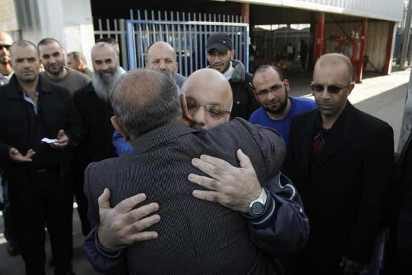 Palestinian Hamas member Attoun is greeted upon his release from an Israeli prison at Qalandiya checkpoint, near Ramallah