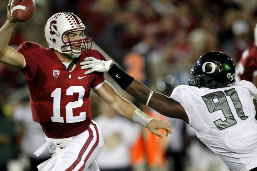 Stanford University quarterback Andrew Luck (12) dodges an attempted tackle by University of Oregon defensive end Tony Washington (91) during the second quarter of their NCAA football game against the University of Oregon in Palo Alto