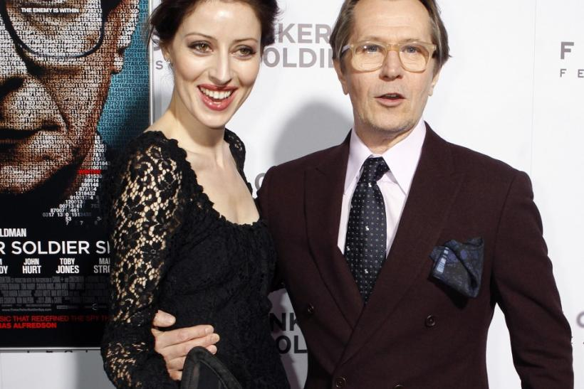 "Cast member Gary Oldman poses with his wife musician Alexandra Edenborough at the Los Angeles premiere of his film ""Tinker, Tailor, Soldier,Spy"" in Hollywood"