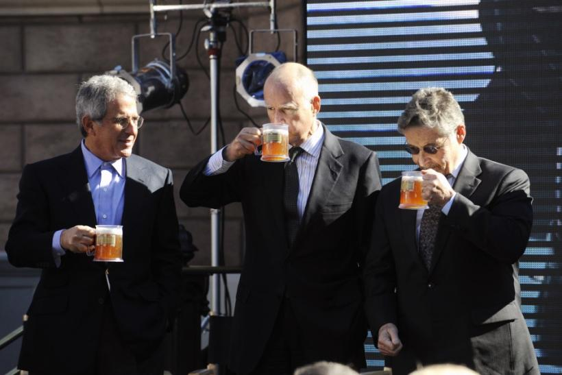 """Universal Studios President and COO Ron Meyer (L), California Governor Jerry Brown (L) and Warner Bros. Chairman and CEO Barry Meyer sample """"butterbeer"""" during an announcement of the new """"The Wizarding World of Harry Potter"""" attraction"""
