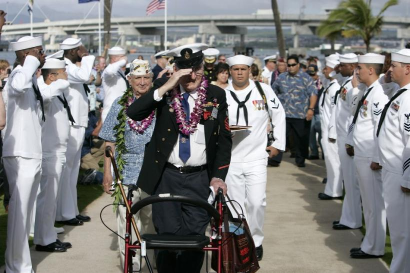"Pearl Harbor survivor Edward Borucki participates in the ""Walk of Honor"" during the 70th anniversary of the attack on Pearl Harbor at the World War II Valor in the Pacific National Monument in Honolulu, Hawaii"