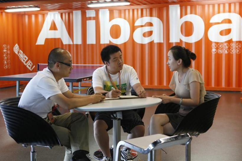 Employees hold a meeting inside the headquarters office of Alibaba (China) Technology Co. Ltd on the outskirts of Hangzhou.