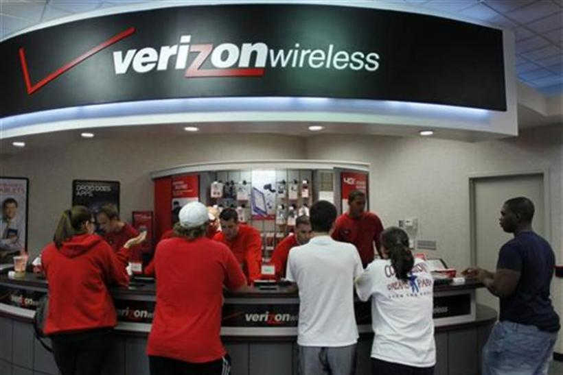 Customers purchase the iPhone 4 shortly after the phone went on sale with the Verizon Wireless network in Boca Raton