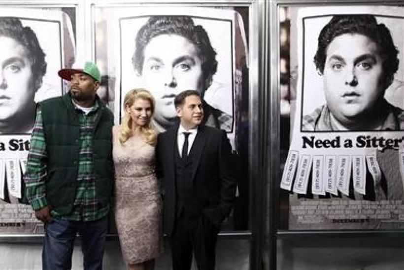 (L-R) Actors Method Man, Ari Graynor and Jonah Hill arrive at the premiere of the movie ''The Sitter'' in New York