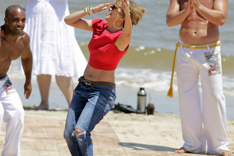"Actress and singer Jennifer Lopez joins in as a group performs Capoeira during the audition of her show ""Q'Viva: The Chosen"" at Ingleses beach in Montevideo"