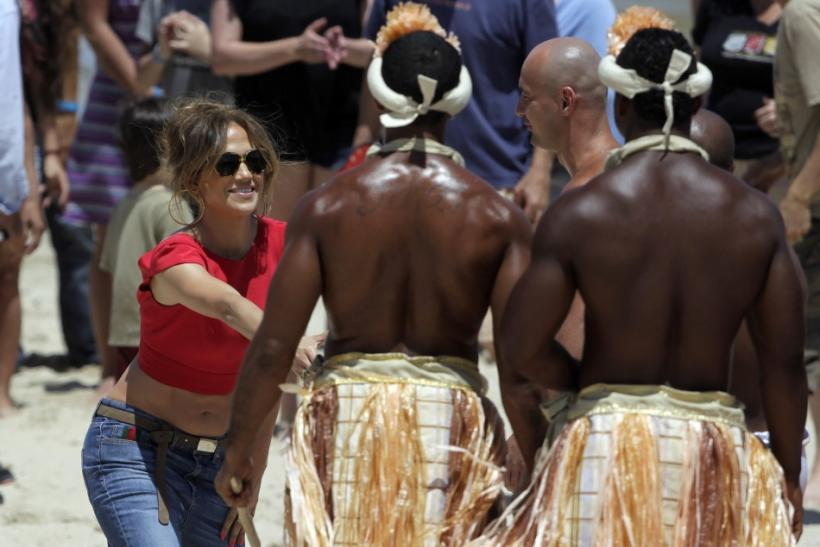 "Actress and singer Jennifer Lopez shakes hands with members of a group performing Capoeira during the audition of her show ""Q'Viva: The Chosen"" at Ingleses beach in Montevideo"