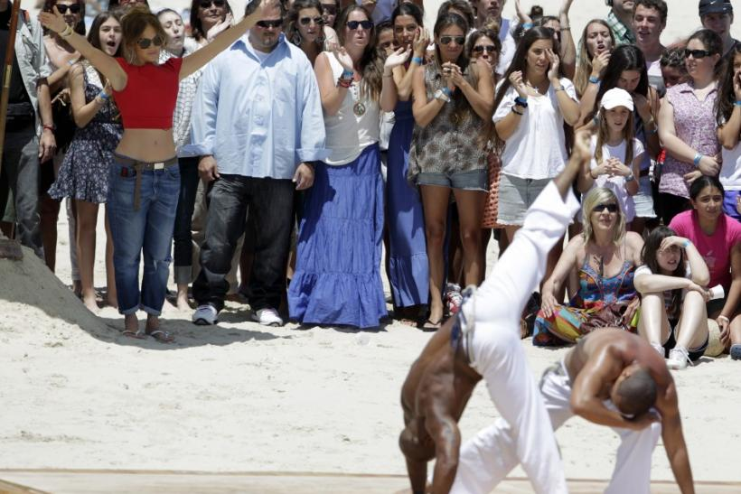 "Actress and singer Jennifer Lopez (L, in red) watches a group perform Capoeira during the audition of her show ""Q'Viva: The Chosen"" at Ingleses beach in Montevideo"