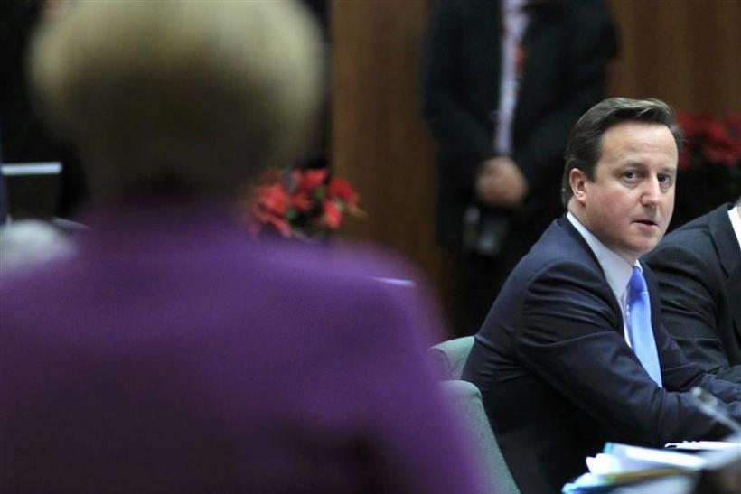 Britain's Prime Minister Cameron looks at Germany's Chancellor Merkel at a European Union summit in Brussels.