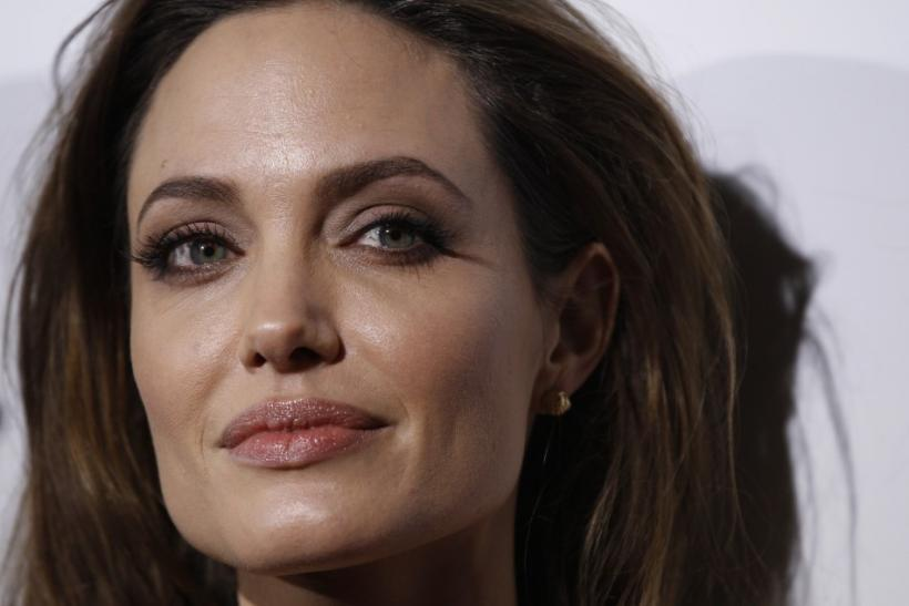 "Director of the movie Angelina Jolie poses at the premiere of ""In the Land of Blood and Honey"" at the Arclight theatre in Los Angeles, California"