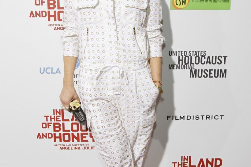 "Singer Gwen Stefani poses at the premiere of ""In the Land of Blood and Honey"" at the Arclight theatre in Los Angeles, California"
