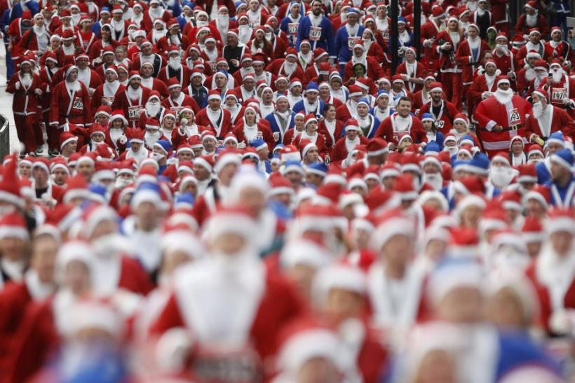 Competitors dressed as Santa Claus take part in the annual five kilometre Santa Dash in Liverpool, northern England