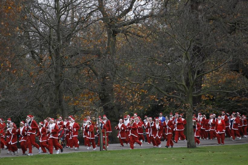 Runners take part in a Santa Claus themed fun run for various charities at Greenwich Park in London