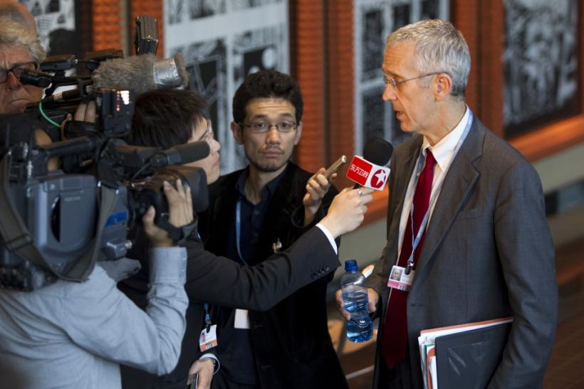U.S. chief climate envoy Todd Stern, right, is interviewed by television crews after an agreement was reached to extend the Kyoto Protocol at the United Nations Climate Change Conference (COP17) in Durban December 11, 2011.