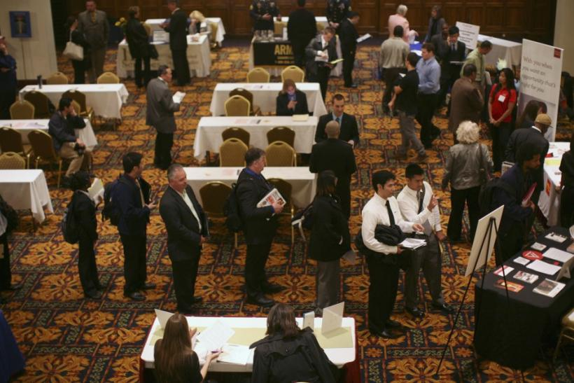 Job seekers stand in line to speak with employers at a job fair in San Francisco, California November 9, 2011.