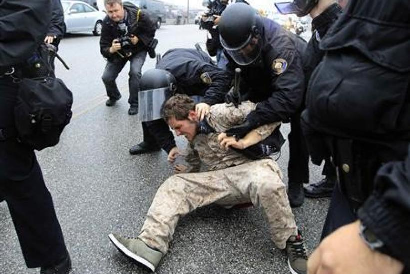 Police arrest a protester during the Occupy movements' attempt to shut down west coast ports in Long Beach, California
