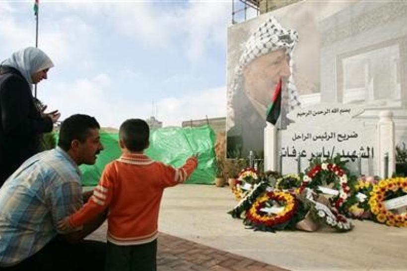 Palestinians visit the grave of late Palestinian leader Yasser Arafat in Ramallah
