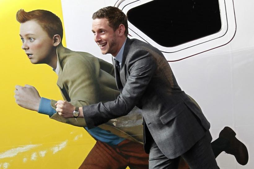 Actor Bell imitates a figure of Tintin painted on a Thalys high-speed train in Brussels