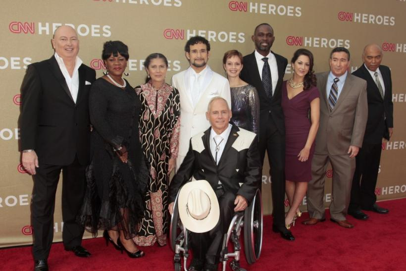 The 2011 CNN Heroes (L-R) Bruno Serato, Diane Latiker, Robin Lim, Sal Dimiceli, Richard St. Denis (seated), Amy Stokes, Derreck Kayongo, Taryn Davis, Eddie Canales and Patrice Millet arrive at the CNN Heroes: An All-Star Tribute event at the Shrine Audito