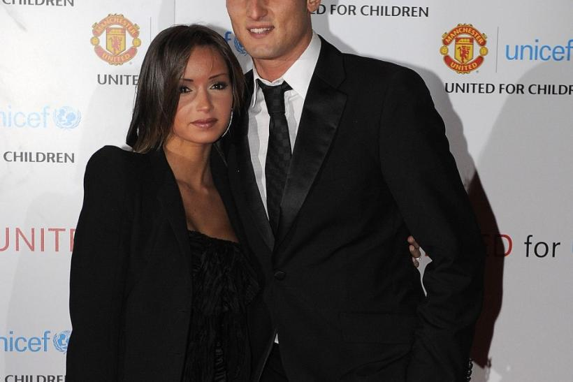 Manchester United's Frederico Macheda and guest arrives for the UNICEF Gala Dinner at Old Trafford Stadium in Manchester, northern England