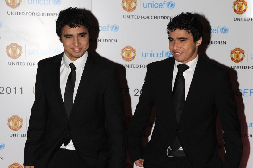 Manchester United's twins Rafael and Fabio Da Silva arrive for the UNICEF Gala Dinner at Old Trafford Stadium in Manchester, northern England