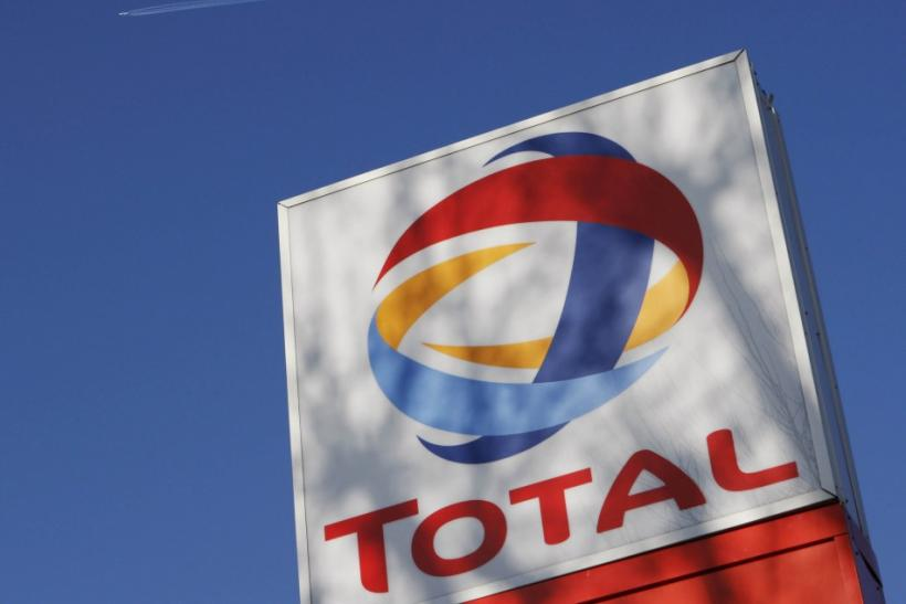 A logo for oil giant Total is seen at a petrol station in London