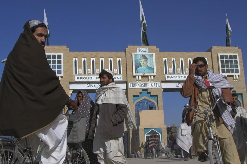 Commuters walk along the Pakistan-Afghanistan border crossing in Chaman