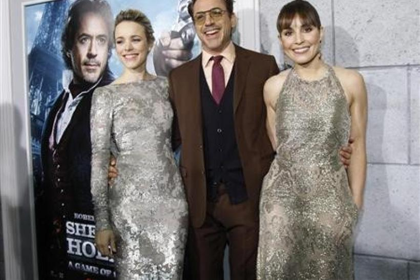 Cast members Robert Downey Jr. (C), Rachel McAdams (L) and Noomi Rapace pose at the premiere of ''Sherlock Holmes: A Game of Shadows'' at the Village theatre in Los Angeles, California