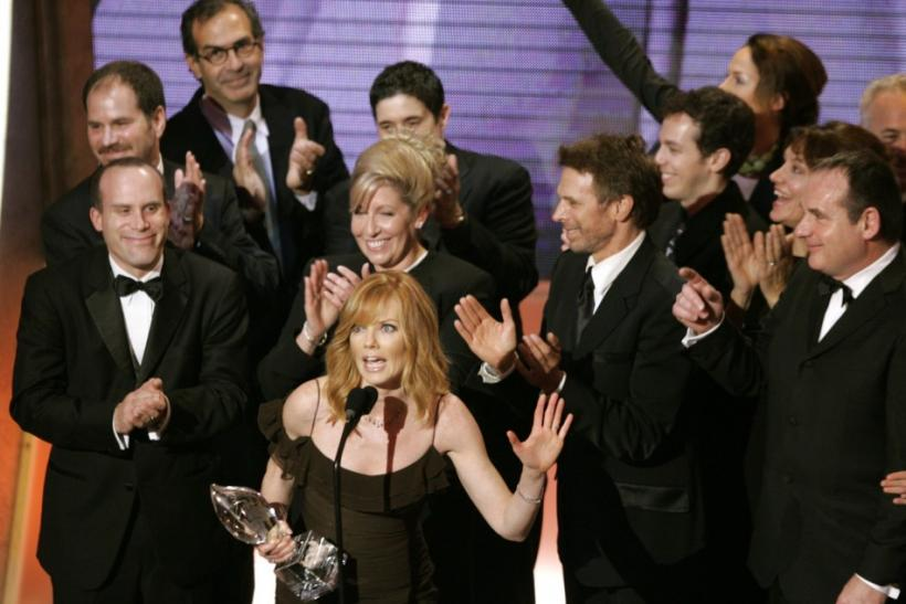 "Cast and crew of ""CSI"" accept award at the 31st annual People's Choice Awards."