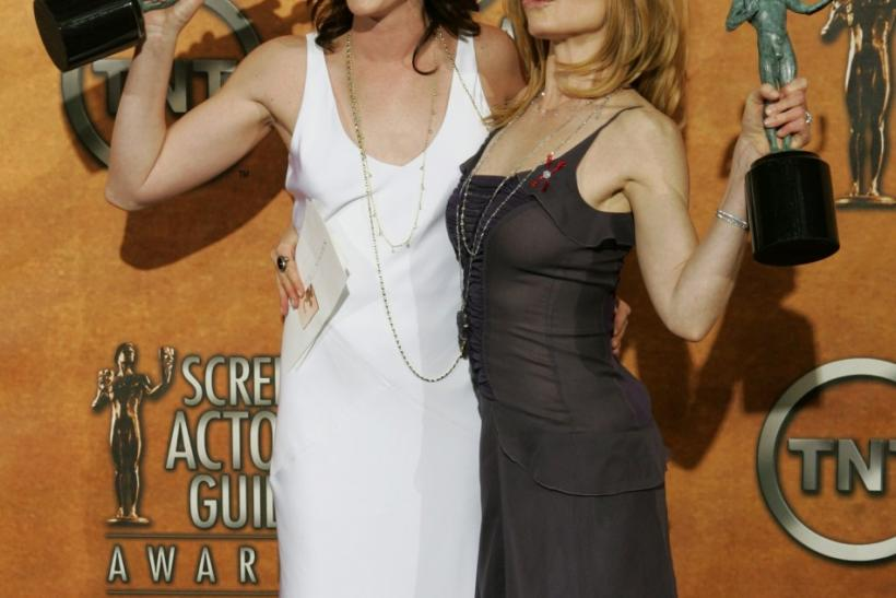 Jorja Fox and Marg Helgenberger hold up their awards during the 11th annual Screen Actors Guild awards.