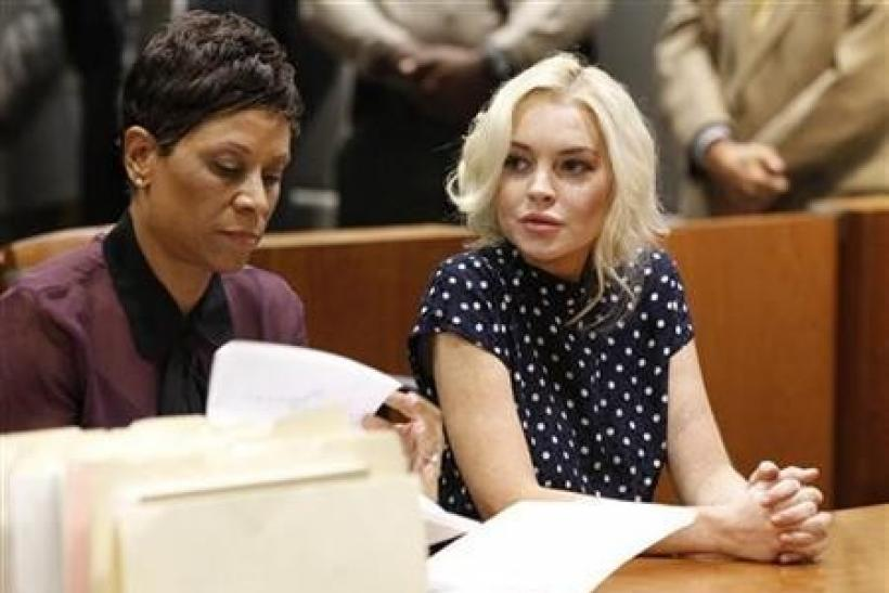Actress Lindsay Lohan (R), accompanied by her attorney Shawn Chapman Holley, attends a probation violation hearing at Airport Branch Courthouse in Los Angeles