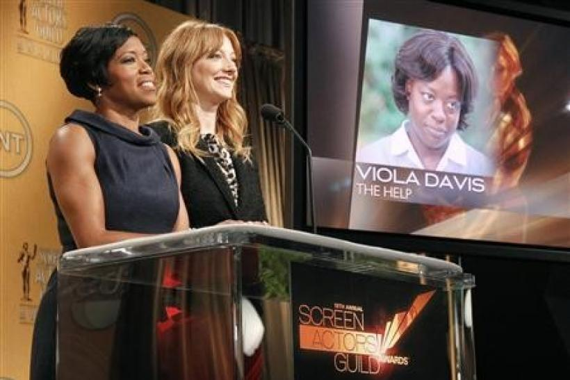 Actresses Regina King (L) and Judy Greer announce Viola Davis as outstanding performance by a female actor in a leading role nominee for her work in ''The Help'' for 18th Annual Screen Actors Guild Awards in West Hollywood