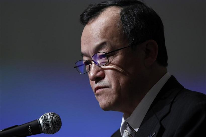 Olympus Corp President Takayama speaks at a news conference in Tokyo