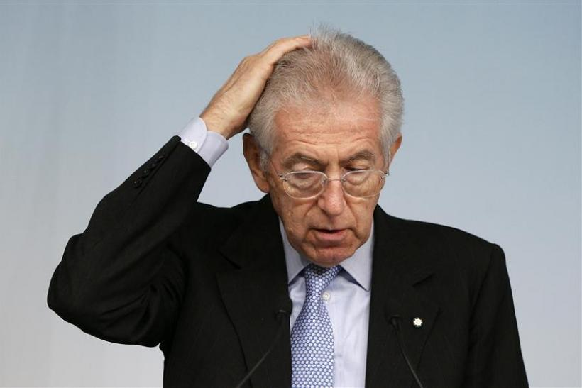 Italy's PM Monti gestures during a news conference in Rome