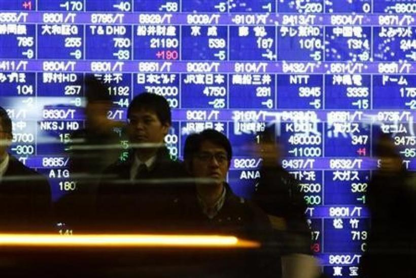 Nikkei posts modest gains but set for losing week