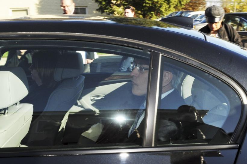 Former Penn State athletic director Tim Curley rides in the back seat of Gary Schultz's car after their arraignment on perjury charges in Harrisburg, Pa., on Nov. 7.