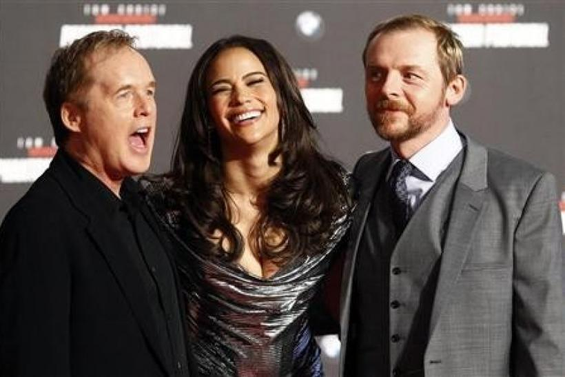 Director Brad Bird and cast members Paula Patton and Simon Pegg (R) pose on the red carpet during the European premiere of the movie ''Mission Impossible: Ghost Protocol''(Phantom Protokoll) in Munich