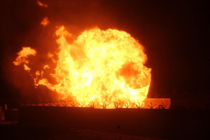 Flames rise from an Egyptian pipeline distribution station after an attack in the Sinai peninsula on July 12 2011