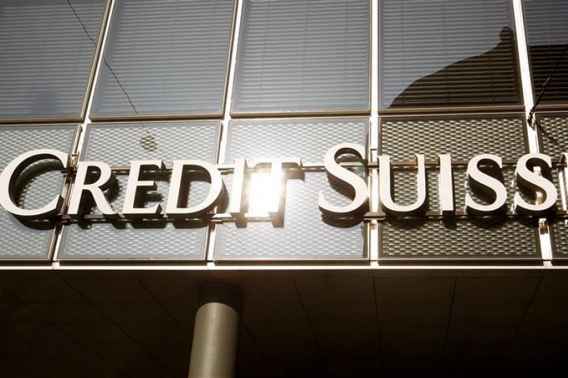 The sun is reflected at the logo of Swiss bank Credit Suisse at a branch office in Basel