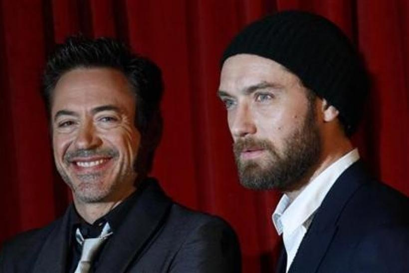 U.S. actor Robert Downey Jr. and British actor Jude Law pose for photographers at the premiere of ''Sherlock Holmes: A Game of Shadows'' at the Empire Cinema in London