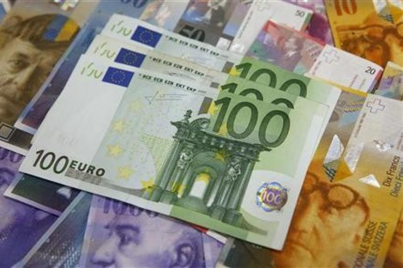 Euro edges lower, hampered by debt, growth worries