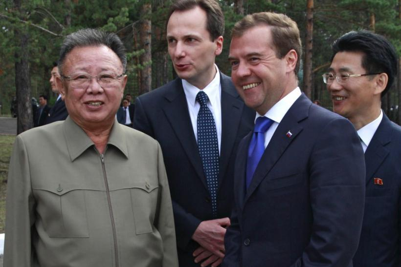 "Russia's President Medvedev and North Korean leader Kim smile during their meeting at the ""Sosnovyi Bor"" military garrison in Siberia's Buryatia region in August 2011."