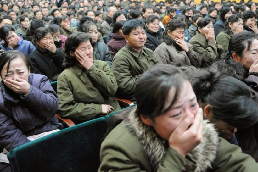 Pyongyang residents react as they mourn over the death of North Korean leader Kim Jong-il in Pyongyang, in this photo taken by Kyodo on December 19, 2011.