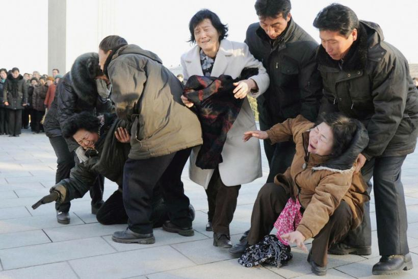 Pyongyang residents react as they mourn the death of North Korean leader Kim Jong-il in Pyongyang, in this photo taken by Kyodo