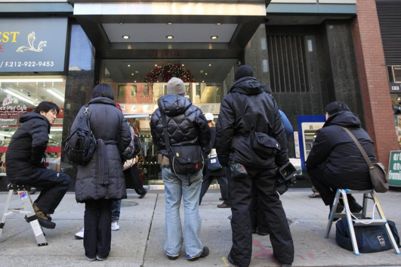 Members of the media wait outside the North Korean mission to the United Nations in New York