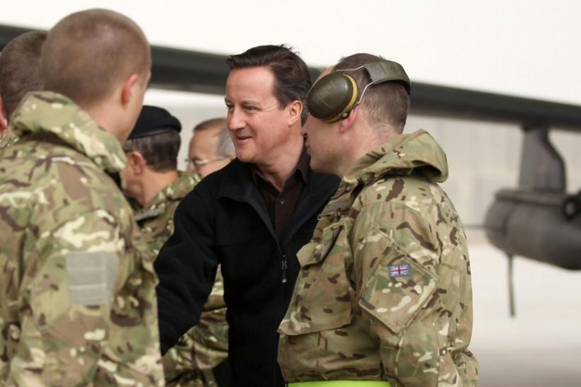 Britain's Prime Minister David Cameron is introduced to British soldiers at Kandahar airfield during a visit to British forces in Afghanistan
