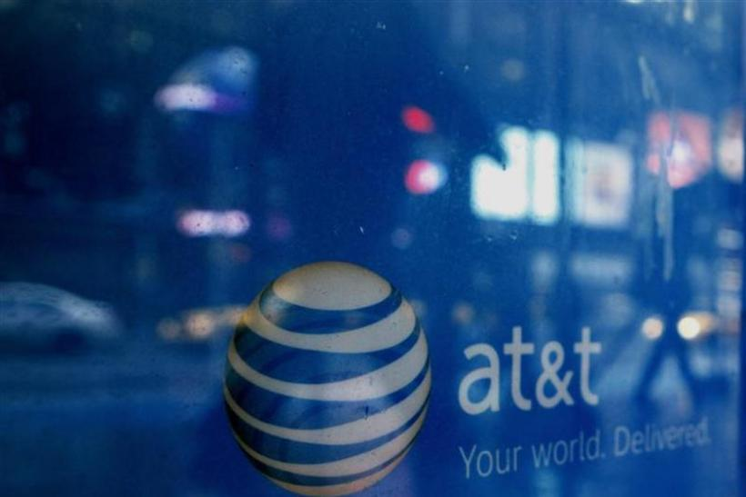 Reflections are seen in the window of an AT&T store in New York