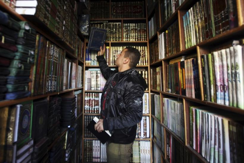 A man browses a selection of Islamic books at a shop in the old city of Cairo