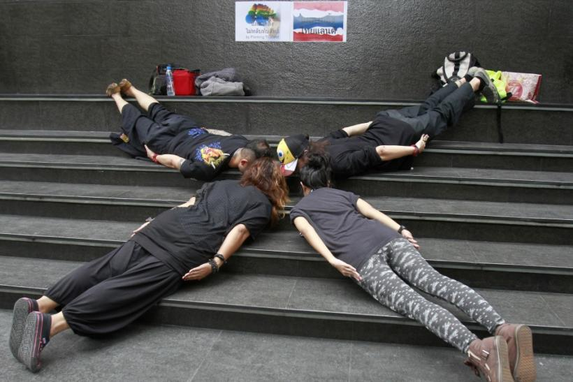 """Members of a group called """"Planking Thailand"""" make a cross formation, to urge people to vote, a day before advance voting commences in Bangkok June 25, 2011."""