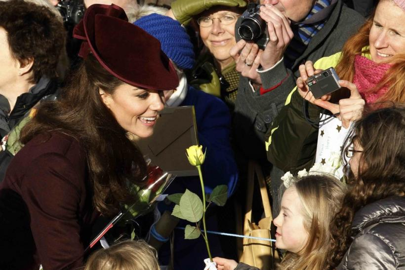 Britain's Catherine, the Duchess of Cambridge greets well-wishers after leaving a Christmas Day service at St Mary Magdalene Church on the Royal estate at Sandringham, Norfolk in east England